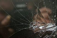 Broken glass on a black. Stock Photos