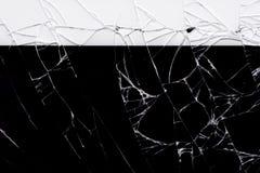 Broken glass on black. Broken flat glass of tablet device on black royalty free stock photos