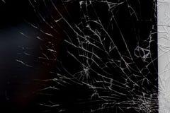Broken glass on black. Broken flat glass of tablet device on black royalty free stock photography