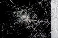 Broken glass on black. Broken flat glass of tablet device on black stock photography