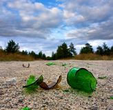 Broken glass bottle Stock Images