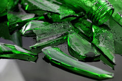 The broken glass bottle and water drops Stock Images