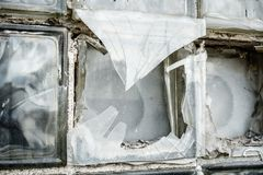 Broken glass box window. Close-up image of a broken glass box window in an abandoned building royalty free stock photography