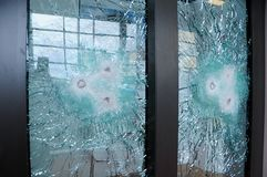 Broken glass with bullets. Bulletproof glass. royalty free stock photos