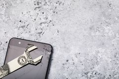 Broken glass on a cell phone screen with copy space. Concept on the cost of repairs. Top view stock photography