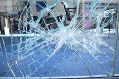 Broken glass. Close up of broken office window glass stock image