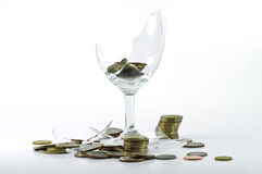 Broken glass and coin Stock Photo