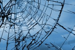 Broken glass. Grid cracks on the glass like cobwebs royalty free stock photo