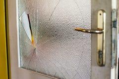 Broken glass on doors. Broken glass on a older wooden doors Stock Images