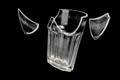 Broken glass with flying pieces. On a black background Royalty Free Stock Image