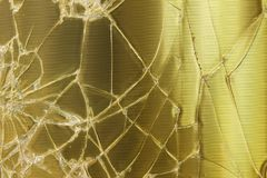 Broken glass gold background royalty free stock image