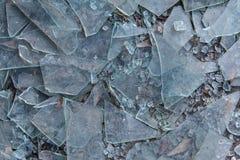Broken Glass Litters Pavement Of Vandalized Business. Broken glass litters pavement of vandalized building Stock Image