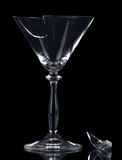 Broken glass martini  fragment isolated on black background. Royalty Free Stock Photography