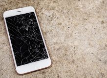 Broken glass of mobile phone screen on concrete floor. Background stock images