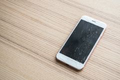 Broken glass of mobile phone screen on wood background. Broken glass of mobile phone screen on wooden background stock image