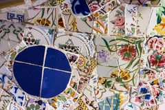 Broken glass mosaic tile, decoration in Park Guell, Barcelona, Spain. Designed by Gaudi Stock Photography