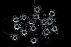 Free Broken Glass Multiple Bullet Holes In Glass Isolated On Black Royalty Free Stock Images - 122729179