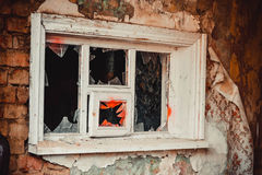 Broken glass in an old window frame Stock Image