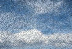 Broken glass pane and blue sky with cloud. Broken glass pane and blue sky with white clouds Royalty Free Stock Images