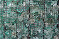 Broken glass panel. A panel made of broken glass in iron net Royalty Free Stock Photo