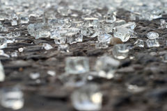 Broken glass on pavement. Broken glass from a car accident on asphalt Stock Photo