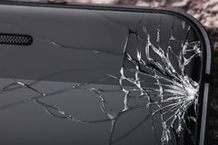Broken glass on the phone screen with copy space.  stock image