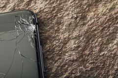 Broken glass on phone screen with copy space. Close-up stock images