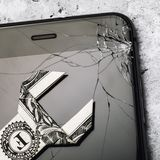 Broken glass on the phone screen and a dollar in the form of a key, as a concept of the cost of repairing a mobile device. Top view stock photos