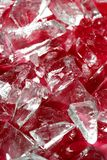 Broken glass pieces over red fake blood Royalty Free Stock Photography