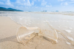 Broken glass plastic on the beach. Stock Images