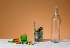 Broken glass and recycled glass bottle Royalty Free Stock Images