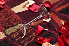 Broken glass and red petals Stock Images