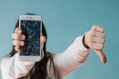 Broken glass screen smartphone in hand of upset woman royalty free stock photo