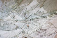 Broken glass shards closeup, texture or background. Broken glass shards close up, texture or background for text stock images