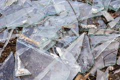 Broken glass shards closeup, texture or background. Broken glass shards close up, texture or background for text stock photography