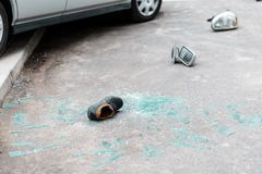 Car parts on the street. Broken glass, shoe and car parts on the street after car crash Stock Photos