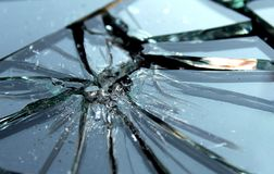 Broken glass with small pieces lies on a black surface royalty free stock photos