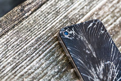 Broken glass of smart phone. On the grunge wood. Copy space. Selective focus. Low depth of field. Color toned image royalty free stock photos