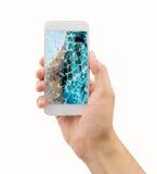 Broken glass of smart phone. Hand holding the smartphone with broken glass Stock Photos