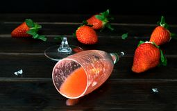 A broken glass of Strawberry Cocktail royalty free stock image