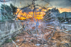Broken glass by the street at sunset Stock Image