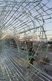 Broken glass at sunset, office building shop window royalty free stock photography