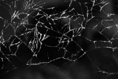 Broken glass texture background of mobile phone. Close up royalty free stock image