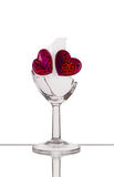 Broken glass with two hearts Stock Photo