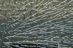 Broken glass. By vandalism fragmented broken glass entrance door Royalty Free Stock Photography