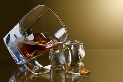 Broken glass of whiskey Royalty Free Stock Images