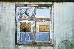 Broken glass in window. Of house now in state of dereliction and ripe for redevelopment stock photo