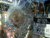 Broken Glass Window. With Old Repair, Concept of Vandalism royalty free stock image