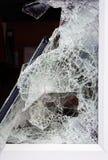 Broken glass in window. stock images