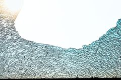 Broken tempered glass pattern. A broken glass window with a hole ,tempered glass toughened glass  crack Royalty Free Stock Photo